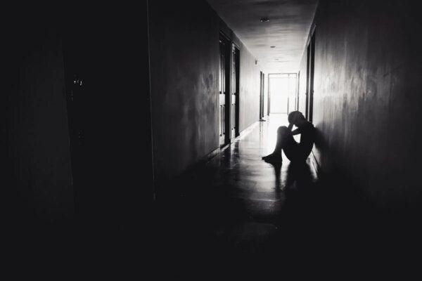 A man sitting in a corridor.