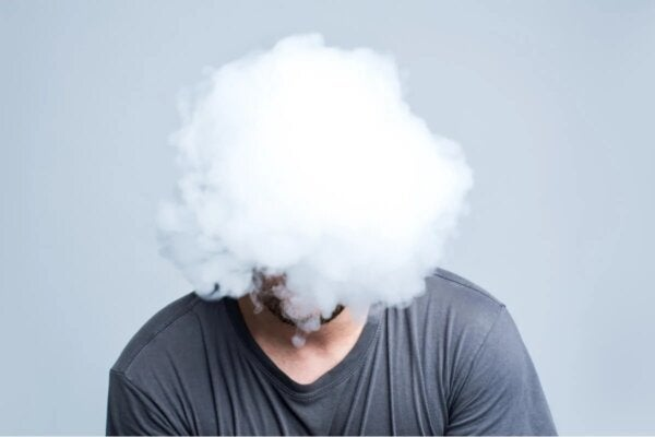 A man's head covered by a cloud.