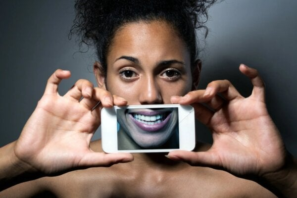 A woman framing her smile.