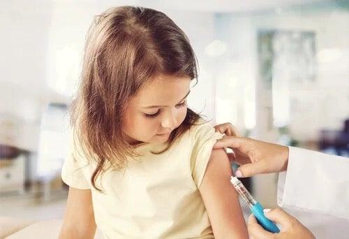 A little girl having a vaccination.
