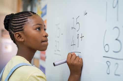 A girl working on a math problem.
