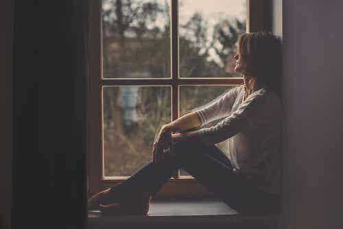 A woman by the window.