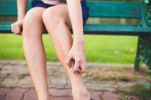 A woman scratching her leg.