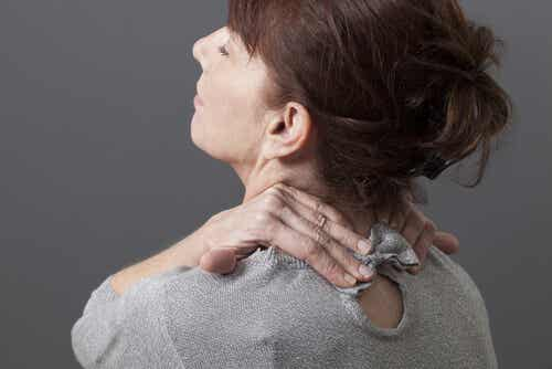 An image of woman with neck pain.