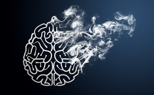 Outline of a brain with smoke coming out showingn what lies behind laziness