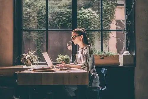 A woman working freelance.