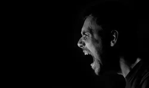 A man screaming.