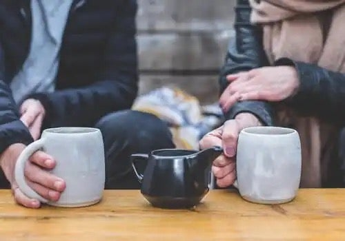 A couple sharing a coffee together, maybe sharing feelings.