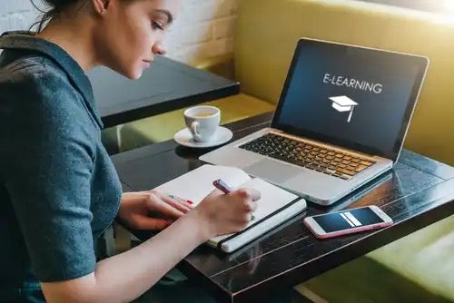 A woman doing online learning.