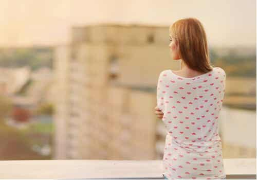 A woman looking at the city.