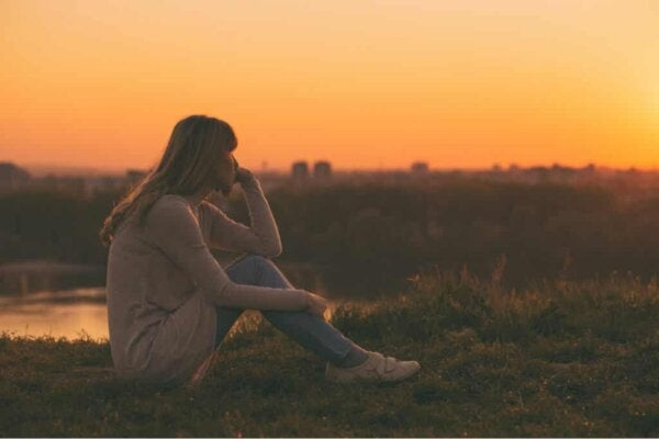 A woman watching the sunset.