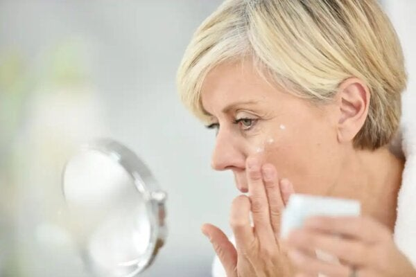 A woman perhaps applying a neurocosmetic cream.