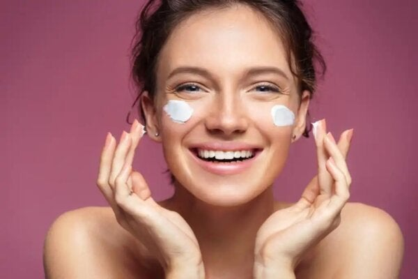 A woman perhaps putting neurocosmetic cream on her face.