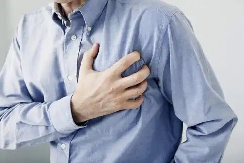 A man clutching his chest.