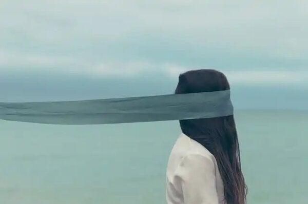 A blindfolded woman.