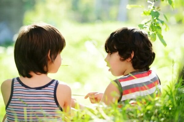 Two young boys talking.