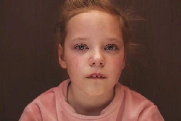 A child crying, indicating negative childhood experiences.