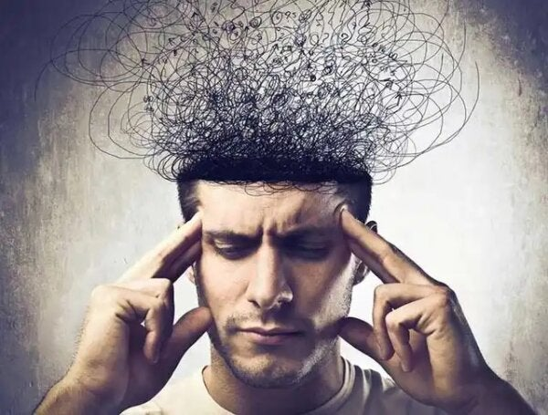 A man with tangled wires for a brain, suggesting limiting beliefs.